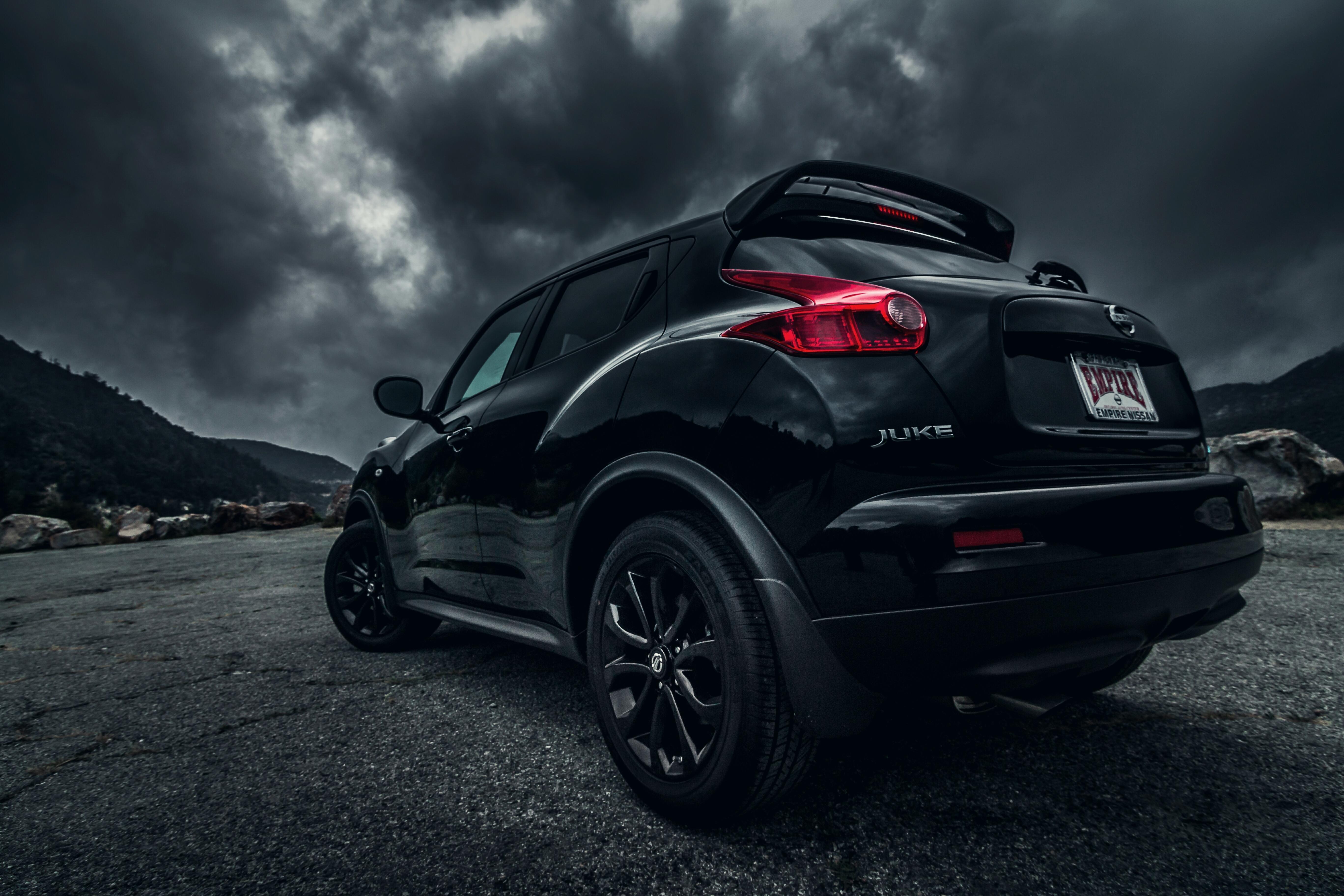Картинка: Автомобиль, Nissan, Juke, чёрный, асфальт, тучи, горы