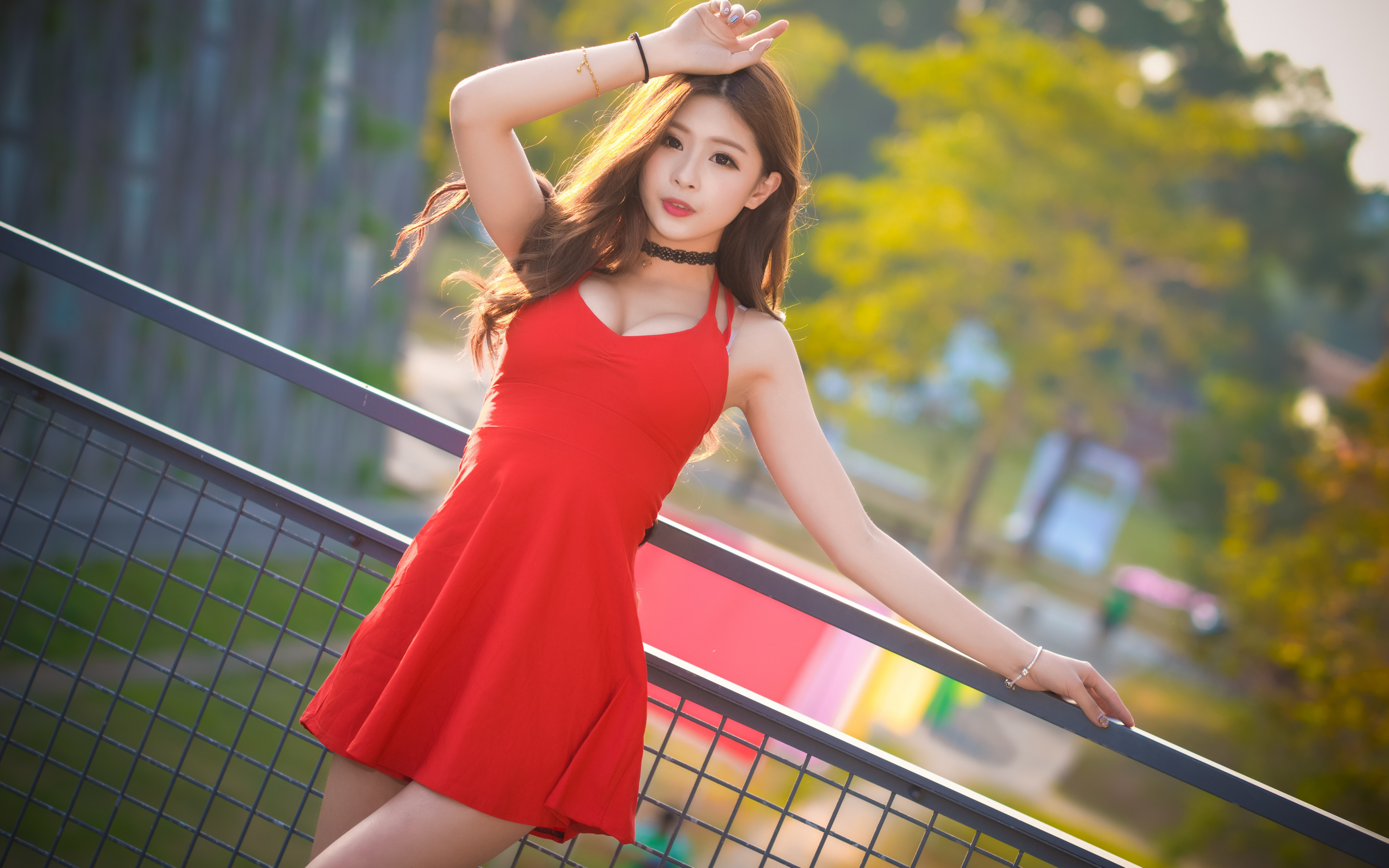 Image: Girl, Asian, hair, dress, red, fence, trees, blurring