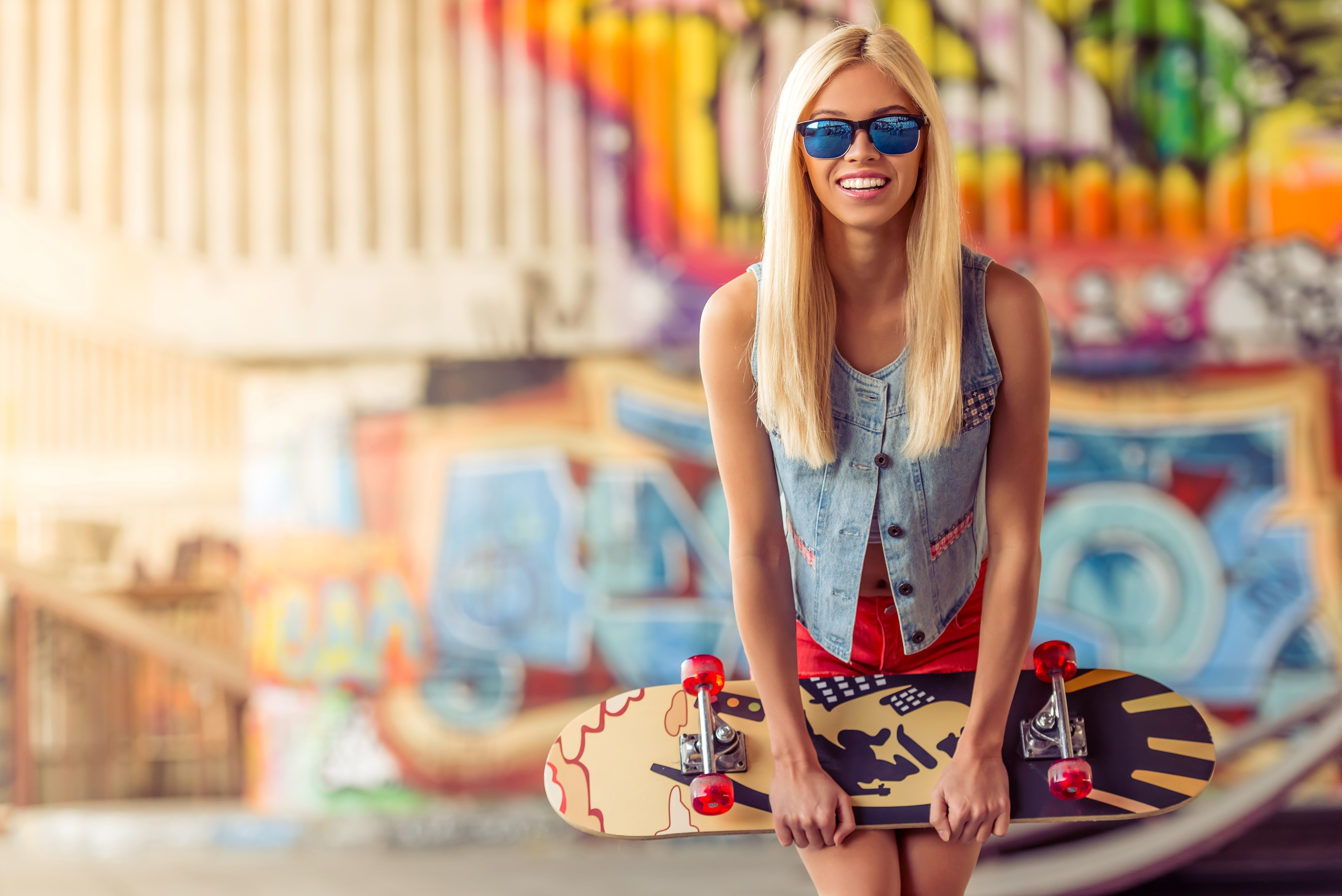 Image: Blonde, glasses, smile, skateboard, blurring, graffiti
