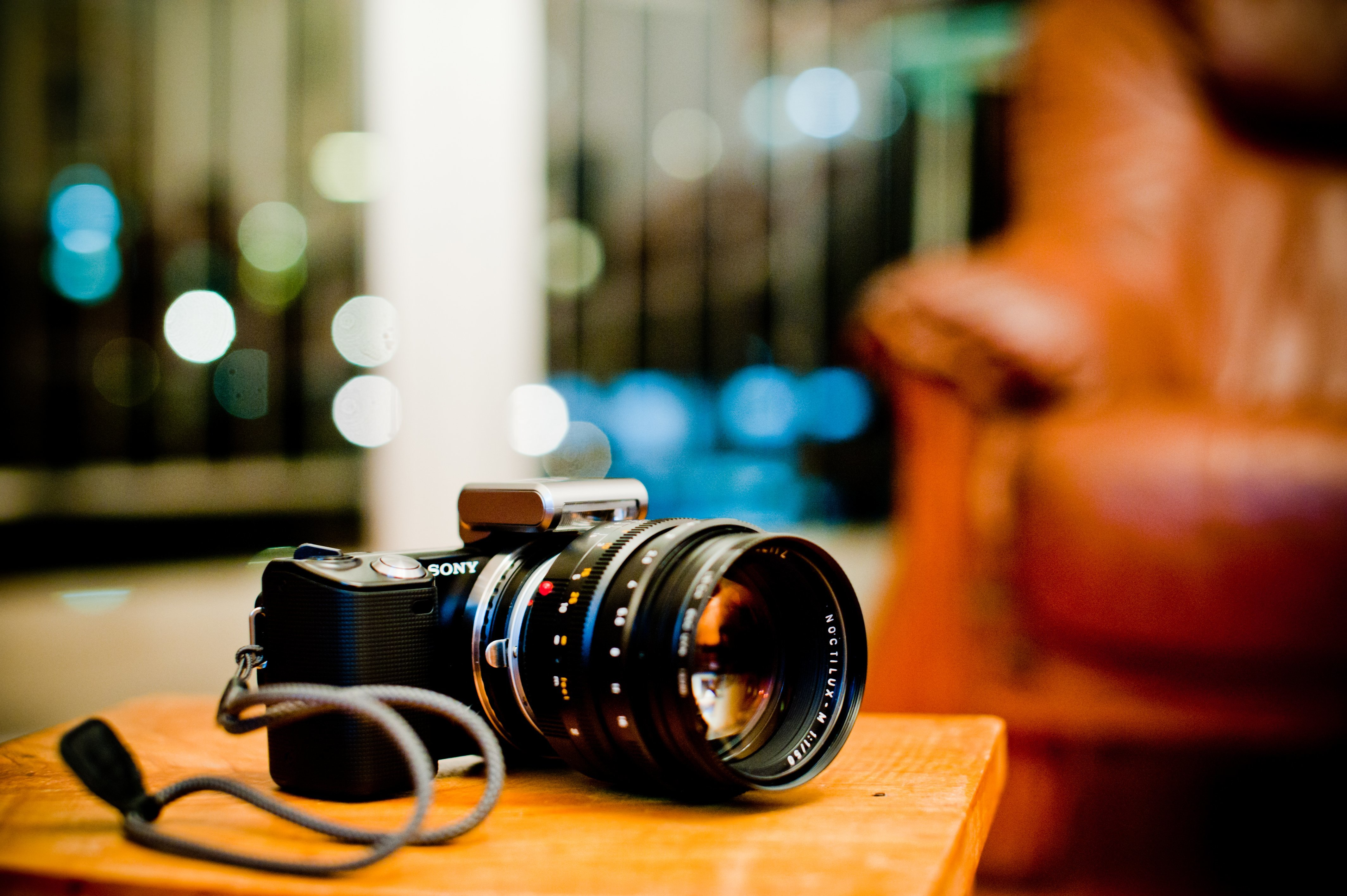 Image: Camera, Sony, lens, flare, table, lies