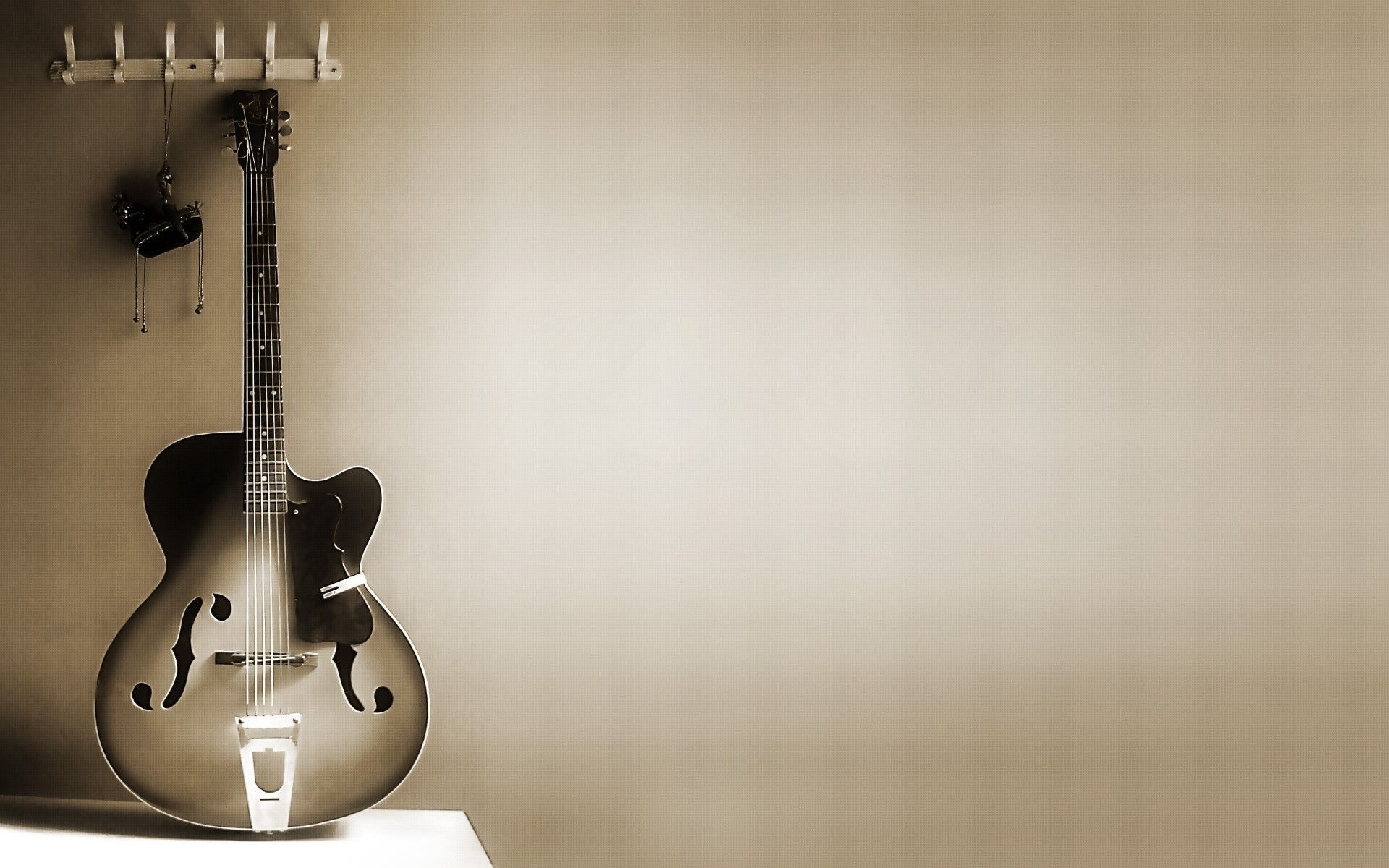 Image: Guitars, strings, wall, grey background