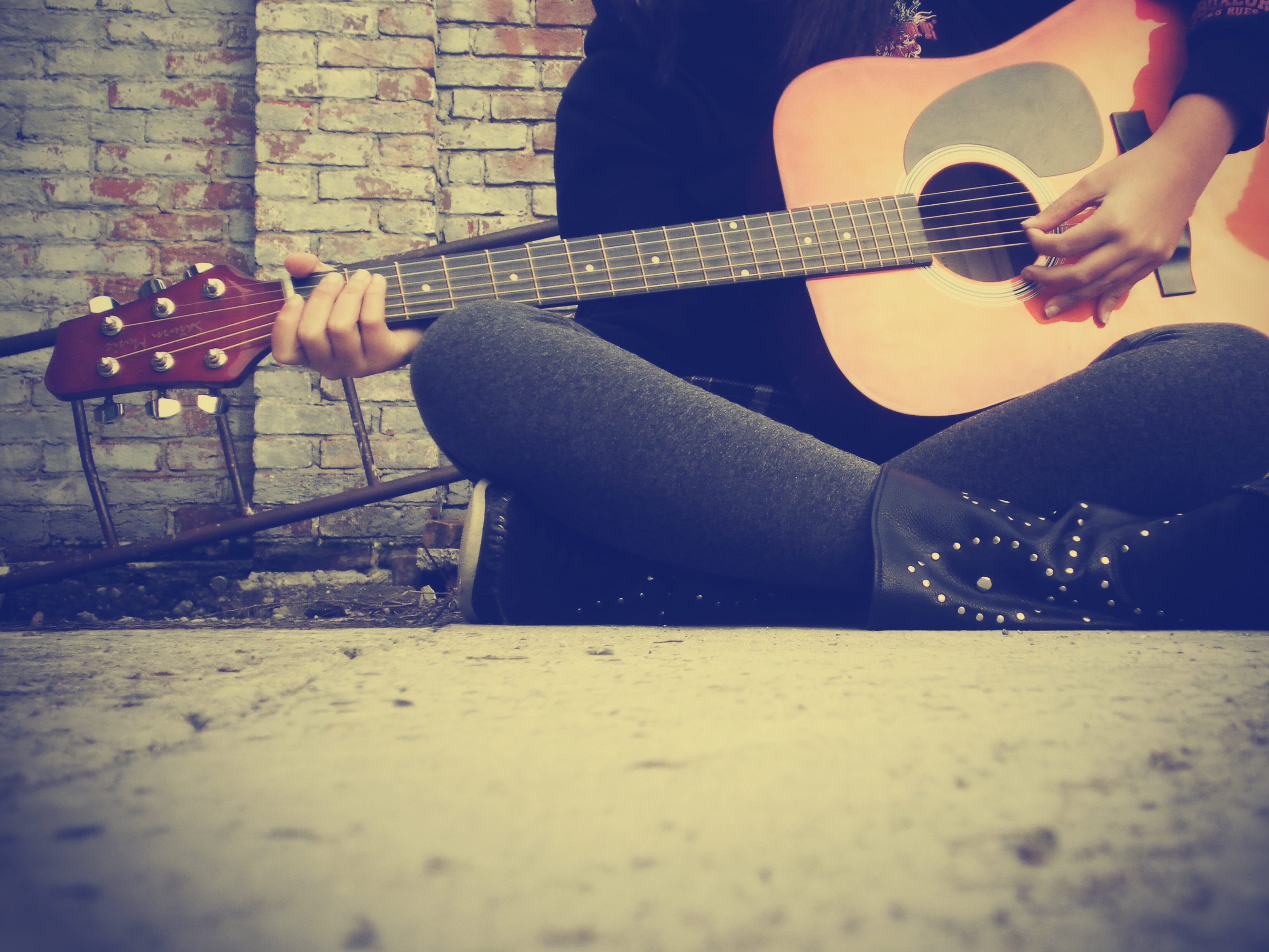 Image: Girl, sitting, guitar, strings, playing, brick wall