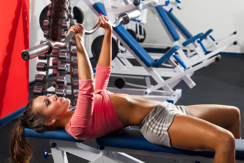 Image: Fitness, sports, girl, brunette, lying, bench press, trainer, dumbbells, gym
