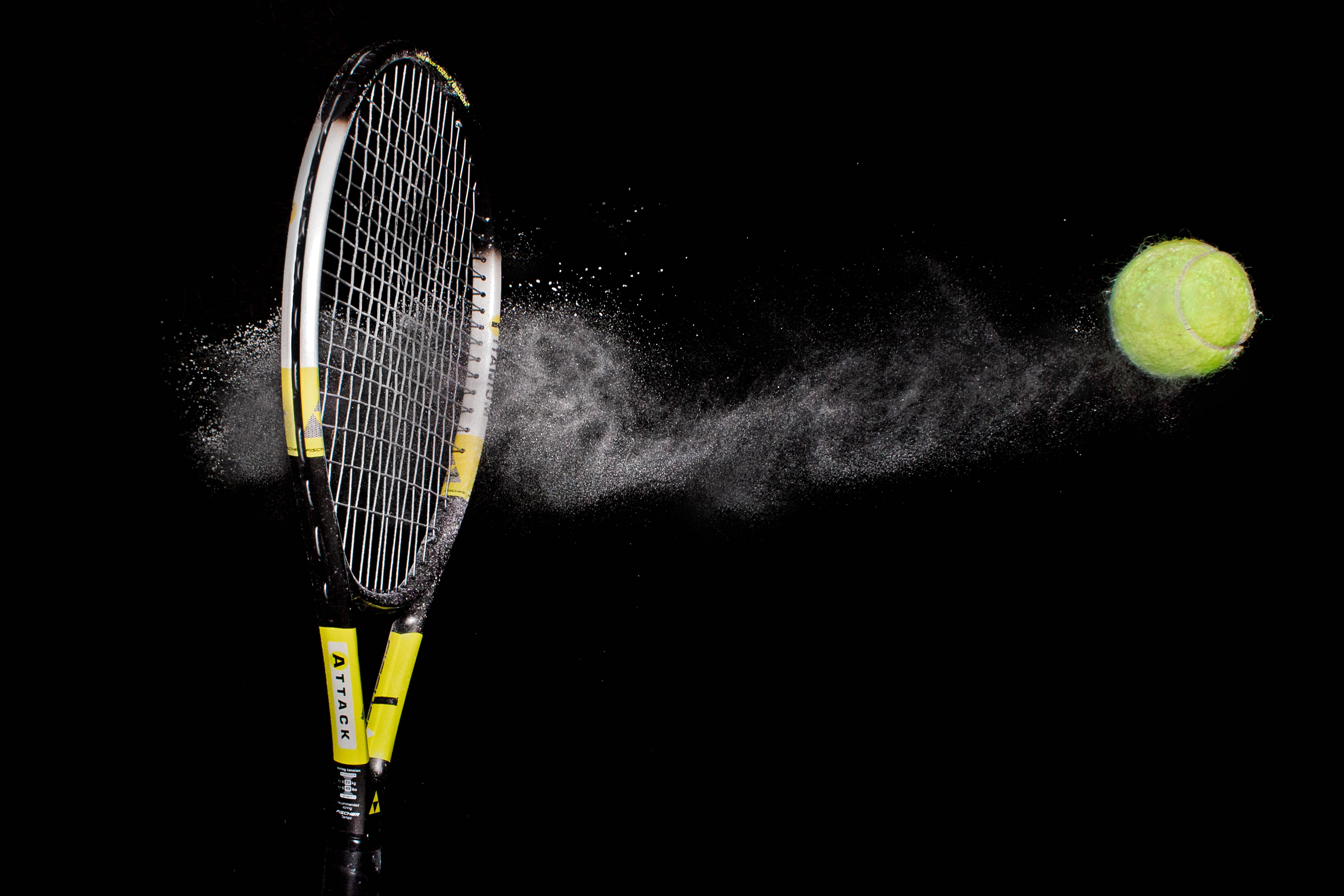 Image: Racket, tennis, ball, strike, black background