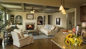 Картинка: Гостиная, комната, декор, камин, огонь, светильники, ковёр, диван, кресло, подсолнухи