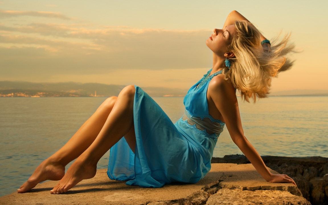Image: Blonde, sitting, stones, rocks, hair, girl, dress, blue color, sea, evening