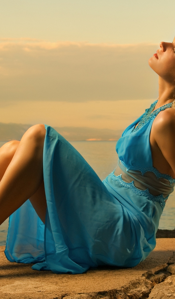 Image: Blonde, sitting, stones, rocks, hair, girl, dress, blue color, sea, evening
